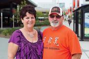 Sharon and Bob Adams show their Ravens and Orioles while strolling along Pratt Street on Sept. 26.