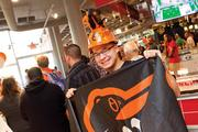 Romeo Santos, a U.S. Army career counselor, swapped his military uniform for Orioles gear to attend a Sept. 26 rally at the McCormick World of Flavor store at the Inner Harbor.