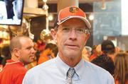 Earl Swartzendruber of Whitman, Requardt & Associates LLC has been known to wear his Orioles cap around the office. Above, Swartzendruber at an Orioles' rally Sept. 26 at the Inner Harbor.