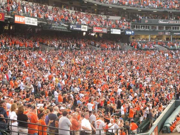 Orioles fans flocked to Oriole Park at Camden Yards on Thursday night. They were also glued to their television sets.