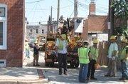Crews on Monday to work restore power in Highlandtown.