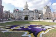 The Ravens' logo has been painted in front of City Hall to celebrate the team's playoff run.