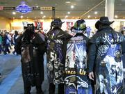 The back of the Ravens-themed trench coats of from left to right, Greg Thompson, Rick Bowlus, Chip Riley and Brian Donley