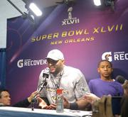 Ray Lewis talks with the press after Super Bowl XLVII, the final game of his 17-year career.