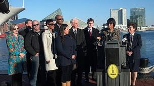 Secretary of Commerce Rebecca Blank, far right, looks on Thursday at Baltimore's Inner Harbor as Mayor Stephanie Rawlings-Blake urges members of Congress to resolve the fiscal cliff.