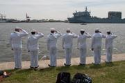 U.S. Navy sailors tribute at Fort McHenry on Wednesday as tall ships begin to make their way into Baltimore.
