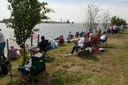 Spectators started gathering at 8 a.m. on Wednesday at Fort McHenry to catch a glimpse of Navy vessels and tall ships pass by.