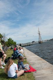 Spectators gather at Fort McHenry on Wednesday as tall ships begin to make their way into Baltimore's harbor.