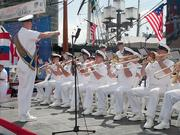 The U.S. Navy Ceremonial Band performs at the Inner Harbor Thursday to help launch the Star-Spangled Sailabration.