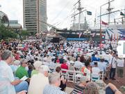A crowd gathers at the Inner Harbor on Thursday as the U.S. Navy Ceremonial Band performs.
