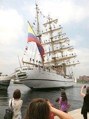 Spectators take pictures on Tuesday as Ecuadorian tall ship Guayas departs Baltimore.