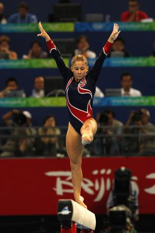 Shawn Johnson of the U.S. performs her routine on the balance beam during the 2008 Beijing Olympics. On Thursday, Under Armour announced a day to outfit the USA Gymnastics team through 2020.