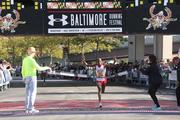 Stephen Muange of Kenya crosses the finish line as the winner of the Baltimore Marathon. He finished in 2 hours and 15 minutes.
