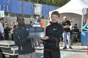 Stephen Muange, the top male runner in the Baltimore Marathon, and Olena-Skurkhno, the top female runner, pose after the race.