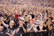 Fans roar as U2 takes the stage for a concert June 22 in Baltimore at M&T Bank Stadium.