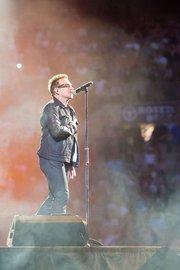 Bono, U2's lead singer, sings to the crowd June 22 in Baltimore at M&T Bank Stadium.