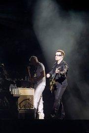 U2 lead singer Bono on guitar during the June 22 concert at M&T Bank Stadium in Baltimore.