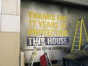 Workers put the finishing touches Friday on a loading dock door that will pay tribute to Ray Lewis outside Under Armour's new Harbor East store.
