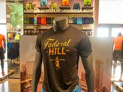 Several shirts in Under Armour's new Harbor East store highlight Baltimore neighborhoods, like Federal Hill.