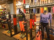 Female mannequinsdisplay the proper attire for spinning, yoga or boot camp. Under Armour's new store in Harbor East includes the sportswear maker's largest collection of female apparel and footwear.