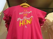 """A children's shirt says """"Welcome to Baltimore, Hon.""""The Under Armour Brand House in Baltimore has a local theme."""