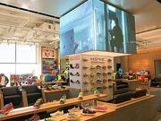 Under Armour footwear occupies the middle of the Harbor East store.