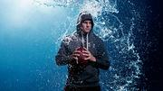 "Under Armour endorser Tom Brady in advertisement for the company's new line of ""Storm Cotton"" a water-resistant product aimed at keeping athletes dry while working out."