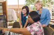 No. 2 in large business: MedStar HealthMedStar's Michele Leadbetter, hand therapist, (left to right), Alethea Wheeler and VP of HR Holly Phipps Adams show team spirit.