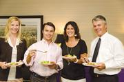 No. 2 in midsize business: First Home Mortgage Corp.  Heidi Ford, Kyle Waters, Tracy Burke and David Waters of First Home Mortgage Corp. enjoy a healthful lunch.