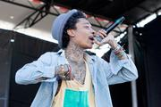 Hip-hop artist Wiz Khalifa performs during the 2012 Preakness InfieldFest at Pimlico Race Course on May 19.