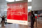"""A sign in the window of the Bank of America downtown says the bank was closed """"due to circumstances beyond our control."""""""