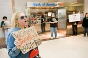 Protestors march outside a Bank of America branch in downtown Baltimore on Thursday.