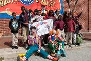 A pair of circus clowns pose with students from Hamilton Elementary/Middle School.