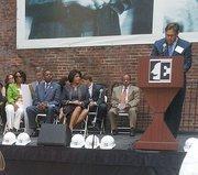 Everyman Theatre Managing Director Ian Tresselt speaks as Mayor Stephanie Rawlings-Blake and other politicians look on.