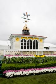 A replica of the old Pimlico clubhouse on the infield of the race course. The owner of Preakness winner receives the Woodlawn Vase at this site following the race.