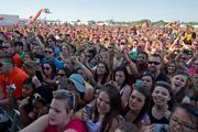Fans watch as Maroon 5 performs during the Preakness infield party.