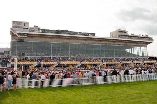 A crowd lines up against the rail at Pimlico before the start of the 136th running of the Preakness Stakes.