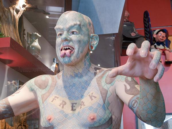 A statue of Erik 'The Lizardman' Sprague inside Baltimore's Ripley's Believe It or Not! The real-life Sprague has sharpened teeth, a full-body tattoo and a tongue cut down the middle.
