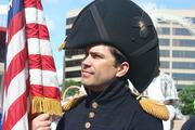 Fort McHenry National Park Ranger Vince Vaise in costume at a press conference Tuesday ahead of the June 13-19 Star-Spangled Sailabration.
