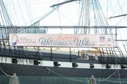 A banner for the Star-Spangled Sailabration is displayed on the USS Constellation at the Inner Harbor.