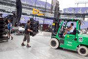 Workers prepare the stage for the U2 concert at M&T Bank Stadium.