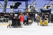 Workers move parts of the stage being erected at M&T Bank Stadium for the U2 concert.