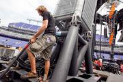 A workers puts the final touches Tuesday on part of the massive steel structure being built at M&T Bank Stadium for the U2 concert.