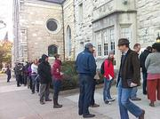 The line to vote outside Brown Memorial Park Avenue Presbyterian  Church in Bolton Hill on Tuesday morning. The line stretched around Park  Avenue and West Lafayette Avenue early in the morning, but subsided to  around 20 people by 8:15 a.m.