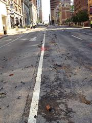 Light Street remained closed on Tuesday morning after a large water main break left damages to the major city artery.
