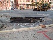 A sinkhole along Light Street where a 20-inch water main burst on Monday.