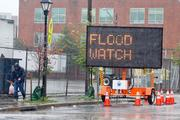 """A """"Flood Watch"""" sign between Harbor East and Fells Point advises drivers of the flooding expected due to Hurricane Sandy."""