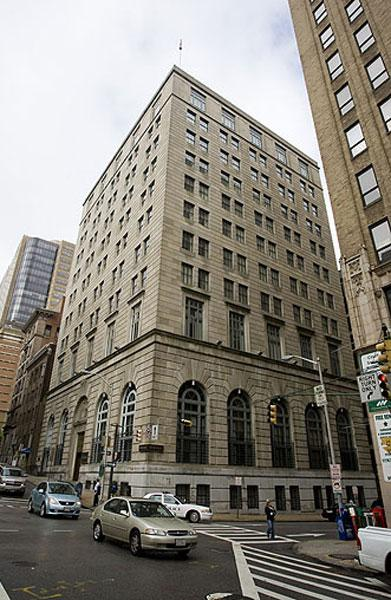 The former bank building at 114 E. Lexington St. will become apartments within about a year.