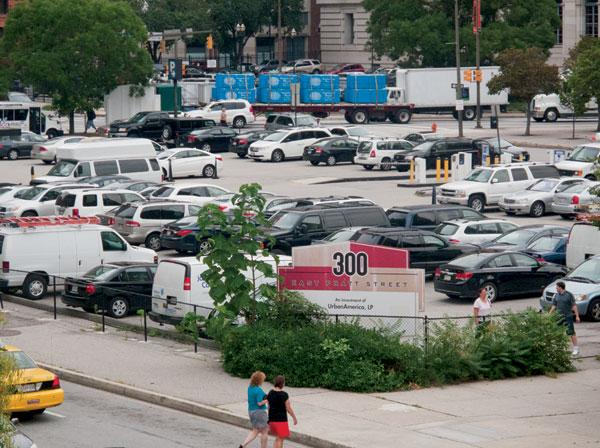 Baltimore officials want to spur development on downtown surface parking lots such as the one at 300 E. Pratt St.
