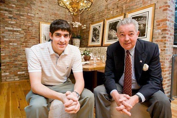 Sinclair CEO David D. Smith (right) sits with son, Blake, inside Ten Ten.